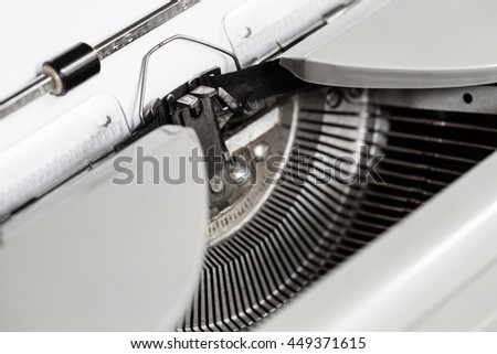 side view of ink ribbon in mechanical typewriter close up - stock photo