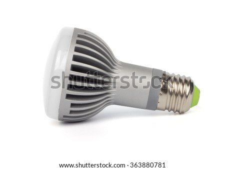 Side view of LED lamp with aluminium radiator and E27 base on white background