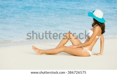 Side view of long haired young woman in swimsuit