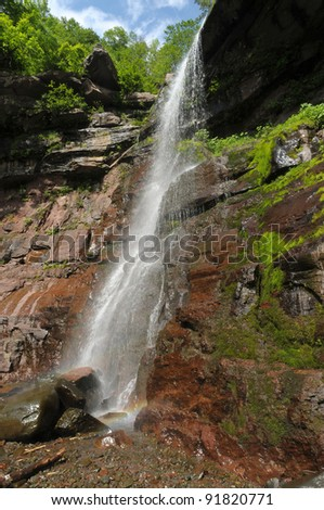 Side view of Lower Kaaterskill falls with rainbow, Upstate New York - stock photo