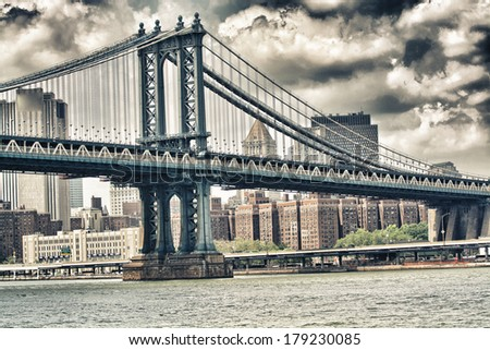 Side view of Manhattan Bridge structure and New York buildings. - stock photo