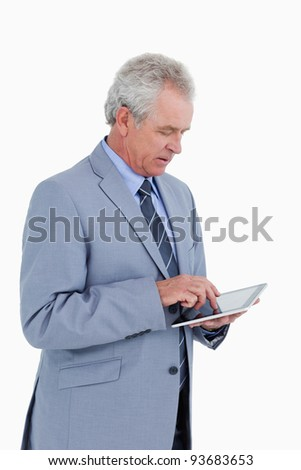 Side view of mature tradesman using tablet computer against a white background - stock photo