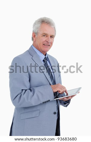 Side view of mature tradesman with tablet computer against a white background