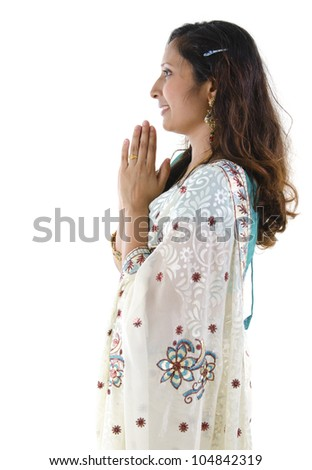 Side view of Mid Adult Indian woman in a greeting pose, isolated white background