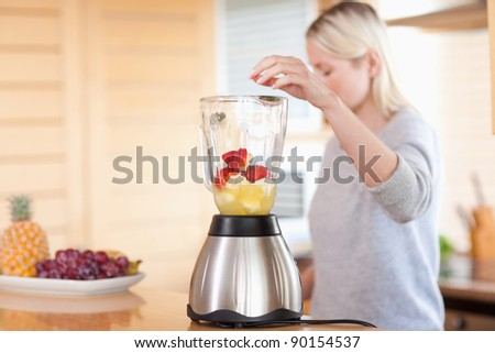 Side view of modern blender getting filled - stock photo