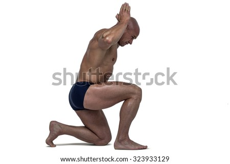 Side view of muscular man exercising against white background