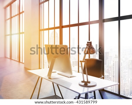Side view of office interior with computer monitor and lamp on desk, chair, concrete floor and window with New York city view. Toned image. 3D Rendering - stock photo