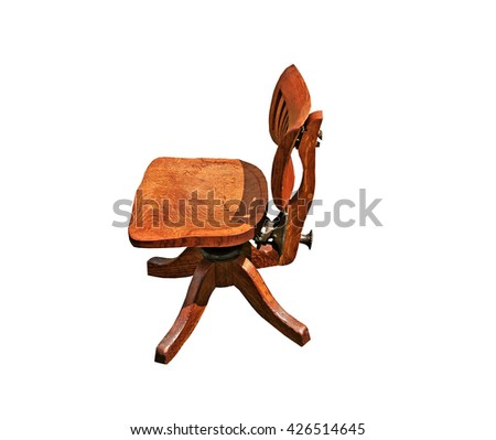 Side view of old small  Oak Swivel Chair - stock photo