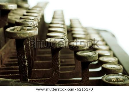 side view of old typewriter, metal looking tint - stock photo