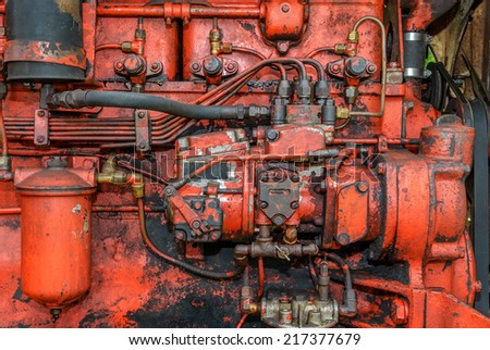 Side View of Orange Vintage Steam  Engine - stock photo