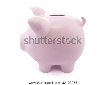 Side view of pink piggy bank with clipping path - stock photo