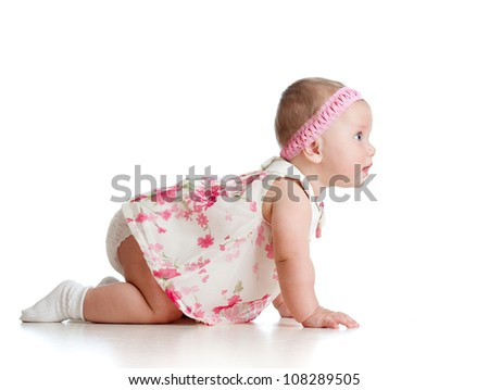 side view of pretty crawling baby - stock photo