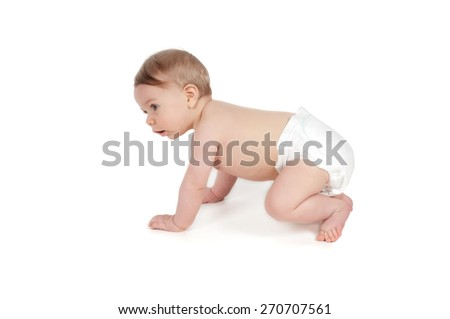 Side view of pretty serious crawling baby - stock photo