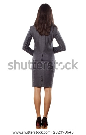 Side view of pretty young businesswoman posing on a white background - stock photo