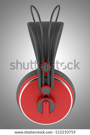 side view of red and black wireless headphones isolated on gray background