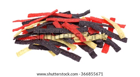 Side view of red blue and natural tortilla strips isolated on a white background. - stock photo