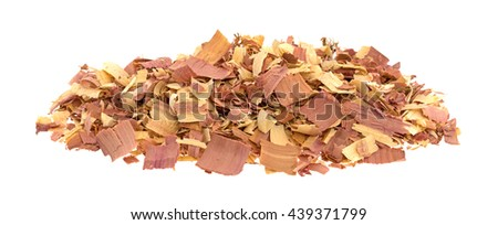 Side view of red cedar shavings used for pet bedding isolated on a white background. - stock photo
