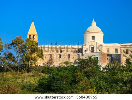 Side view of Saint Vincent Cathedral on Stromboli island, Aeolian Islands, Sicily, South Italy. - stock photo
