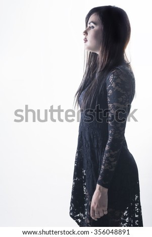 Side view of sexy woman with black dress over white background