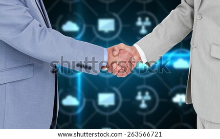 Side view of shaking hands against apps interface - stock photo