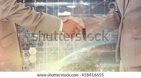 Side view of shaking hands against image of a earth - stock photo