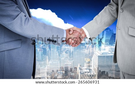 Side view of shaking hands against new york - stock photo