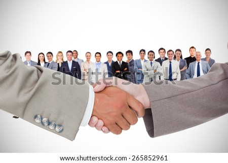 Side view of shaking hands against white background with vignette - stock photo