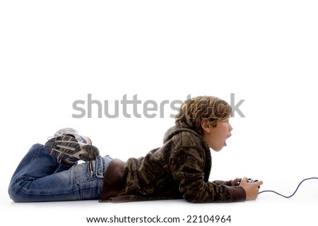 side view of shocked boy playing video game with white background - stock photo