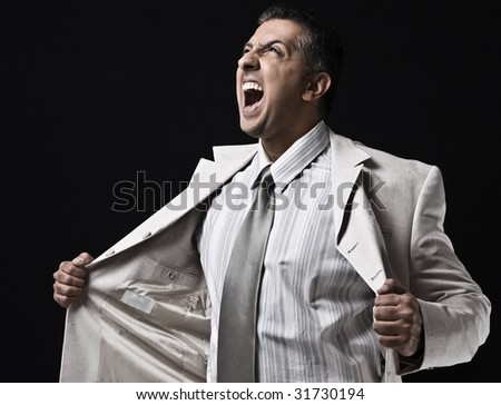 side view of shouting ceo holding his coat - stock photo