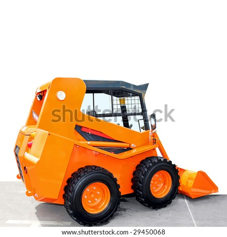 Side view of small orange digger machine - stock photo