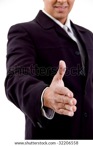 side view of smiling businessman offering hand shake on an isolated background - stock photo