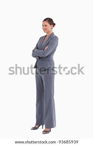 Side view of smiling tradeswoman with folded arms against a white background - stock photo