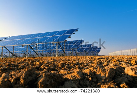 Side view of solar panels for power production. - stock photo