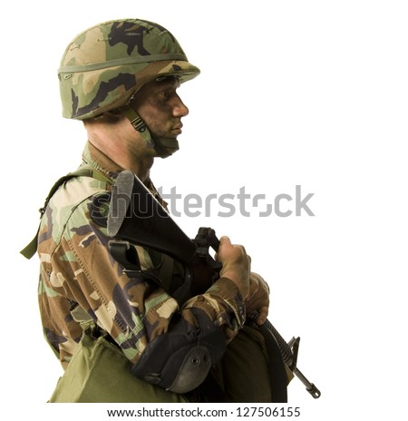 Side view of soldier in uniform with gun