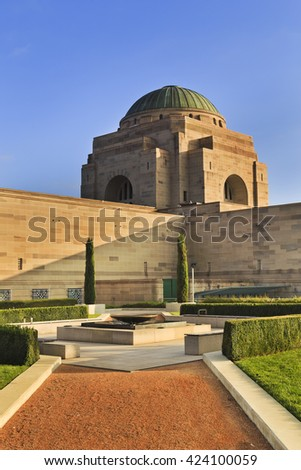 Side view of stylish War memorial museum complex in Canberra, ACT. Stone garden to commemorate memory of all lost at wars. Public building with free access. - stock photo