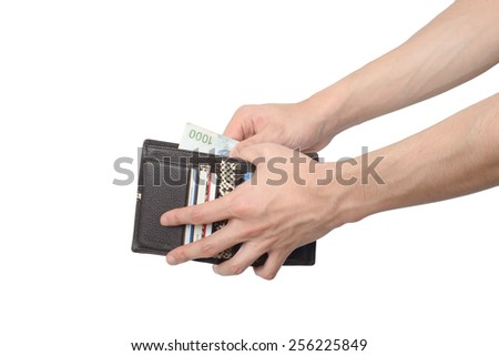 side view of taking some bills out of a wallet