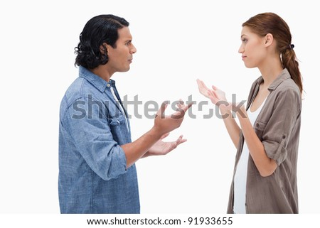 Side view of talking couple against a white background - stock photo