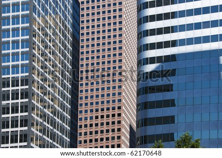 Side view of tall modern skyscrapers - stock photo
