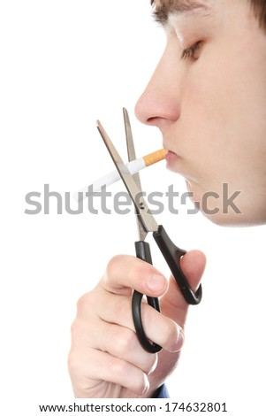 Side view of Teenager cutting a Cigarette with Scissors Closeup on the White Background