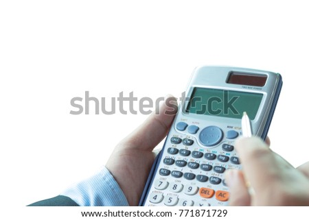 Side view of the accountant hand. He uses a calculator and writes numbers. Accounting concepts,isolate