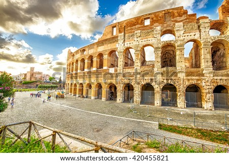 Side view of the coliseum, Colosseum, Flavian Amphitheatre, the largest amphitheater in the world and one of the symbols of Italy. Symbol of Rome, located in historical center, Unesco Heritage Site. - stock photo