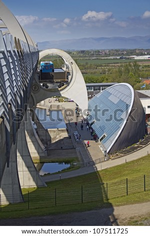 Side View of the Falkirk Wheel descending carrying a passerger barge. Falkirk, Central Scotland, UK. - stock photo