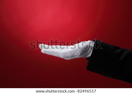 side view of the hand with white glove - stock photo