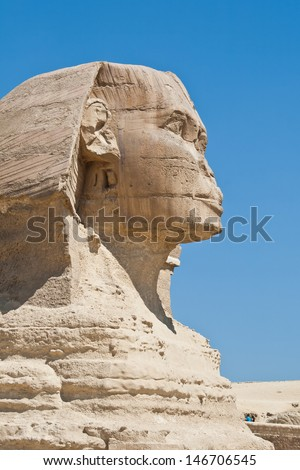 Side view of the head of a sphinx large in Giza, Egypt