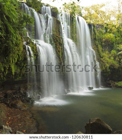 Side view of the idyllic and silky Llano de Cortes waterfall near Bagaces, Costa Rica - stock photo