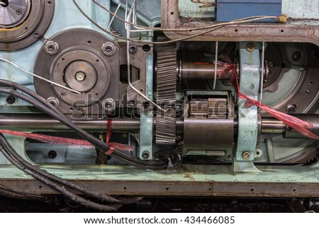 Side view of the old aged offset printing machine driving part, showing the gears Shafts and some other parts which drive the machine - stock photo