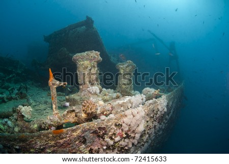 Side view of the shipwreck SS Thistlegorm. SS Thistlegorm, Straights of Gubal, Red Sea, Egypt. - stock photo