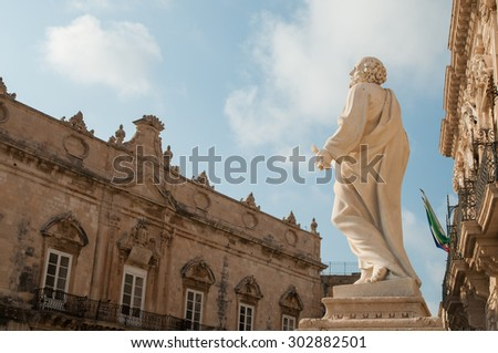 Side view of the statue of St. Peter outside of the Cathedral of Syracuse - stock photo