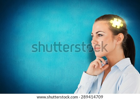 Side view of thinking businesswoman against blue background