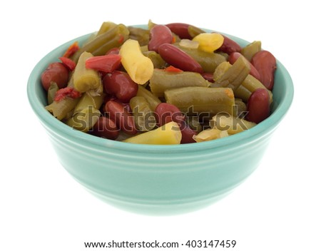 Side view of three bean salad in a small bowl isolated on a white background. - stock photo